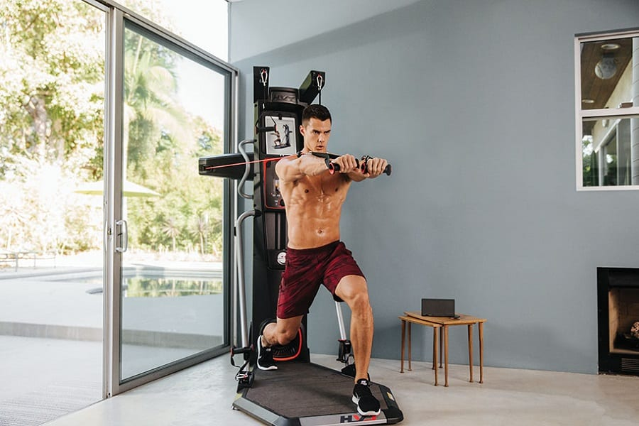 man on bowflex home gym