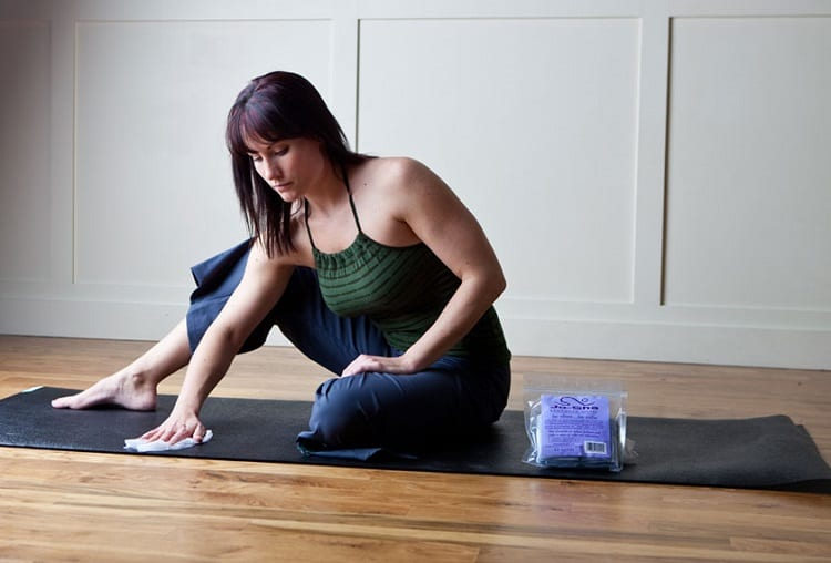 Woman Cleaning Gym Mat