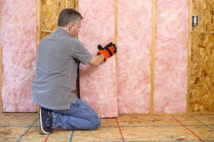 Man Adding Insulation In Garage