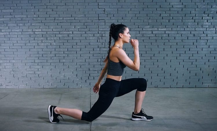 Woman Doing Jumping Lunges