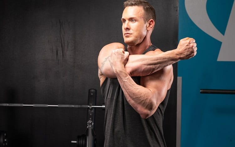 Man Warming Up For Chest Workout