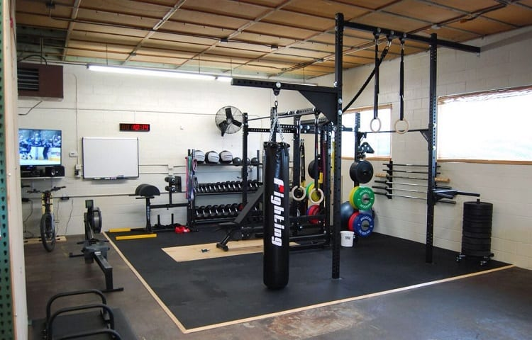 garage gym with wall mounted fan