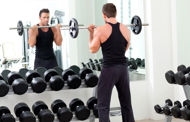 man training in front of mirror