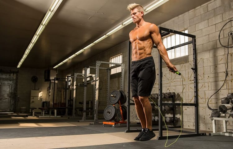 fit man training with weighted rope